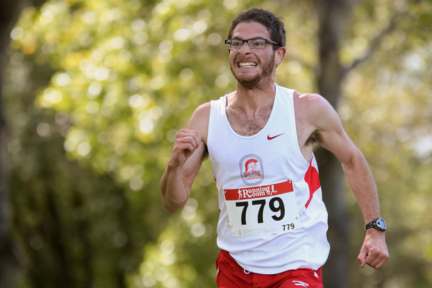 Ending Strong: Josh Inhaber of the Trojans Athletics Club rushes to the finish line during the second ACAC Cross Country Grand Prix of the season at Confederation Park earlier this season. (Photo by Brent Calver/The Press)