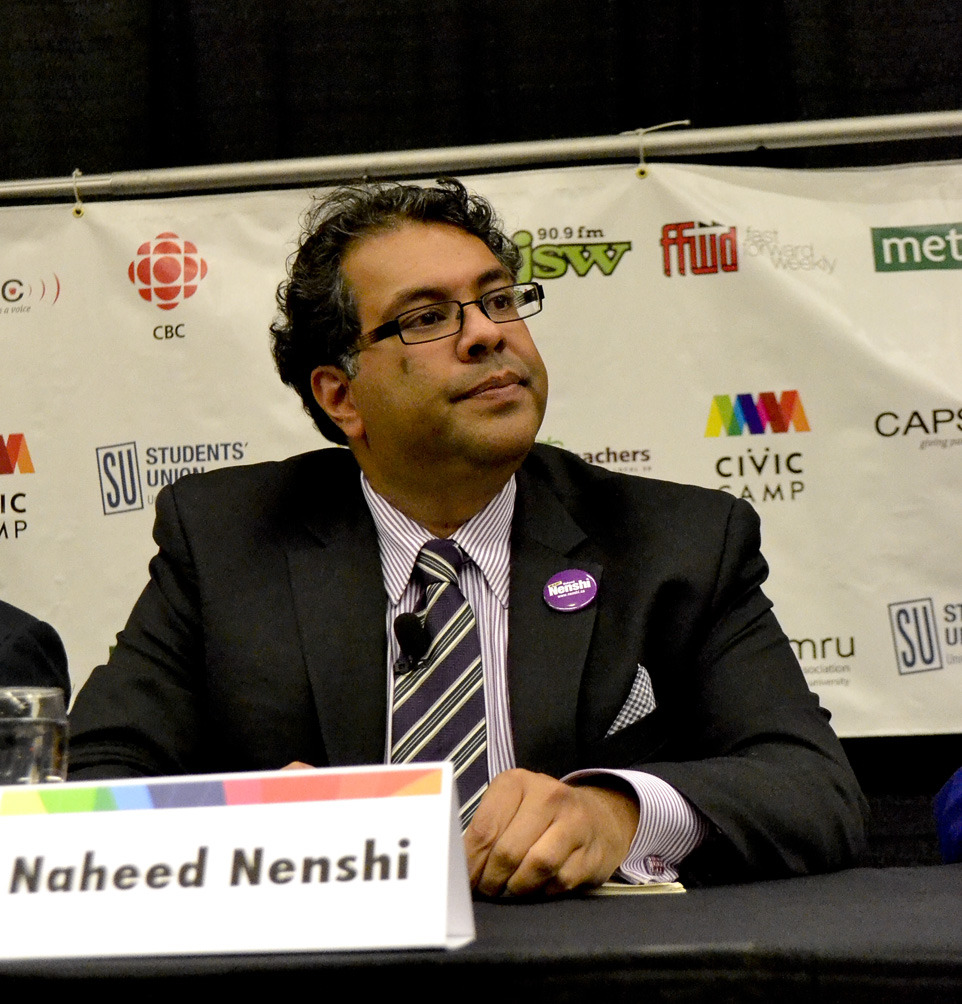 Mayor Nenshi pays attention to the discussion at hand at  a public forum held at the MacEwan Ballroom at the University of Calgary, Calgary on Monday, Oct. 7 2013.