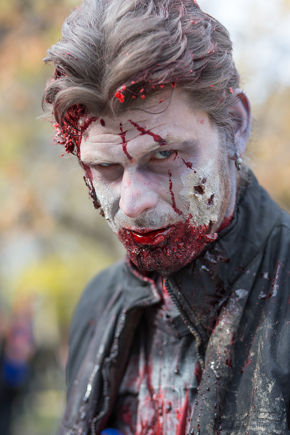 Zombie Apocalypse: Jesse Doherty shows off his make-up before the annual Zombie Walk at Olympic Plaza in Calgary on Saturday, Oct. 12, 2013. Hundreds gathered for the walk, dressed in their scariest zombie costumes to parade down Stephen Ave. (Photo by Jenn Sieppert/The Press)
