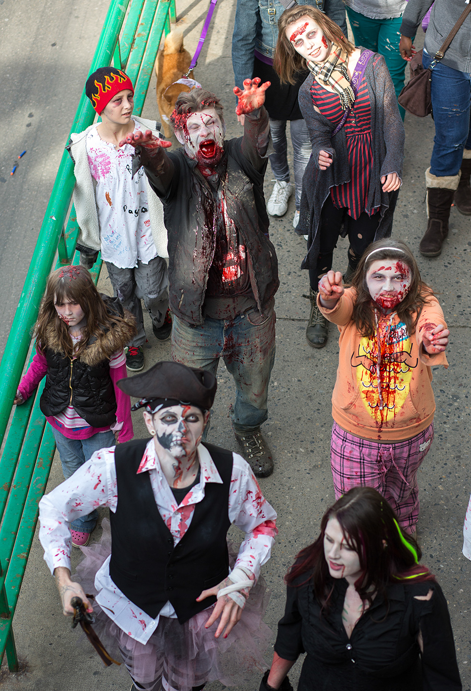 Zombie Apocalypse: Zombie Walk participants search for brains as they march down 4th Street in downtown Calgary on Saturday, Oct. 12, 2013. Hundreds gathered for the walk, dressed in their scariest zombie costumes to parade down Stephen Ave. (Photo by Jenn Sieppert/The Press)