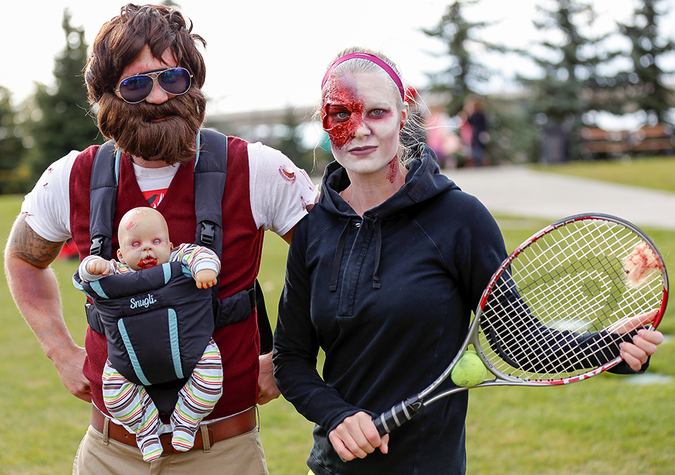 Zombie Apocalypse: Zombie aficionados put on their best costumes to participate in the annual zombie walk in Calgary on Saturday, Oct. 12, 2013. Zombies Morgan Waker, Jessica Ekstom, and baby Carlos giving their take on the zombie apocalypse . (Photo by Anthony Samson/The Press)