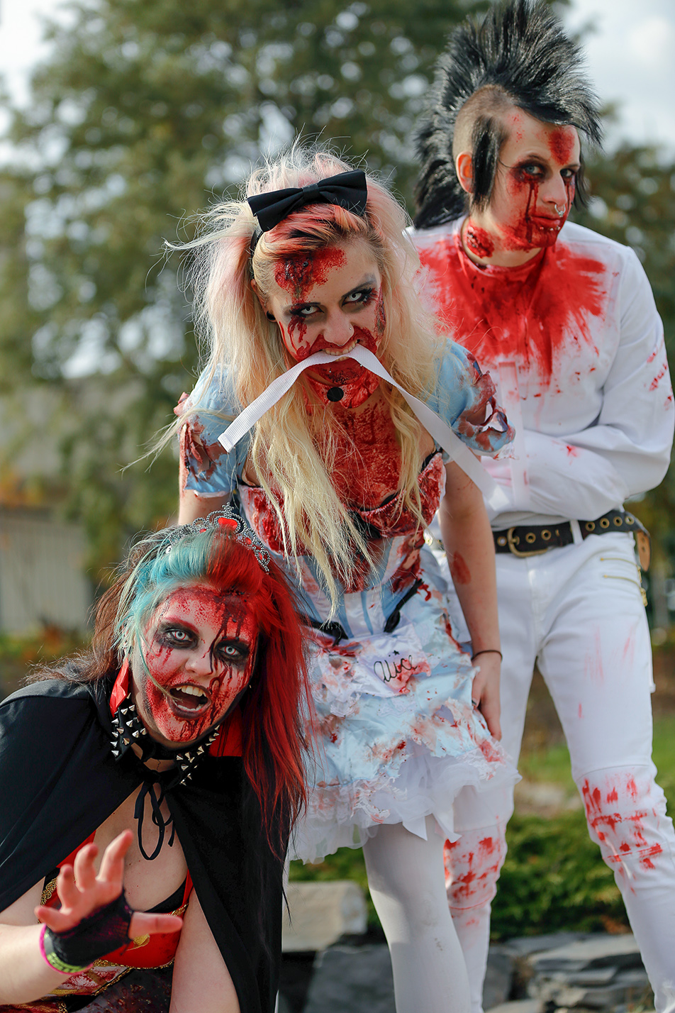 Zombie Apocalypse: Zombie aficionados put on their best costumes to participate in the annual zombie walk in Calgary on Saturday, Oct. 12, 2013. Zombies Emily Young, Tianna Nason, and Benjamin Saville are ready to eat some brains. (Photo by Anthony Samson/The Press)