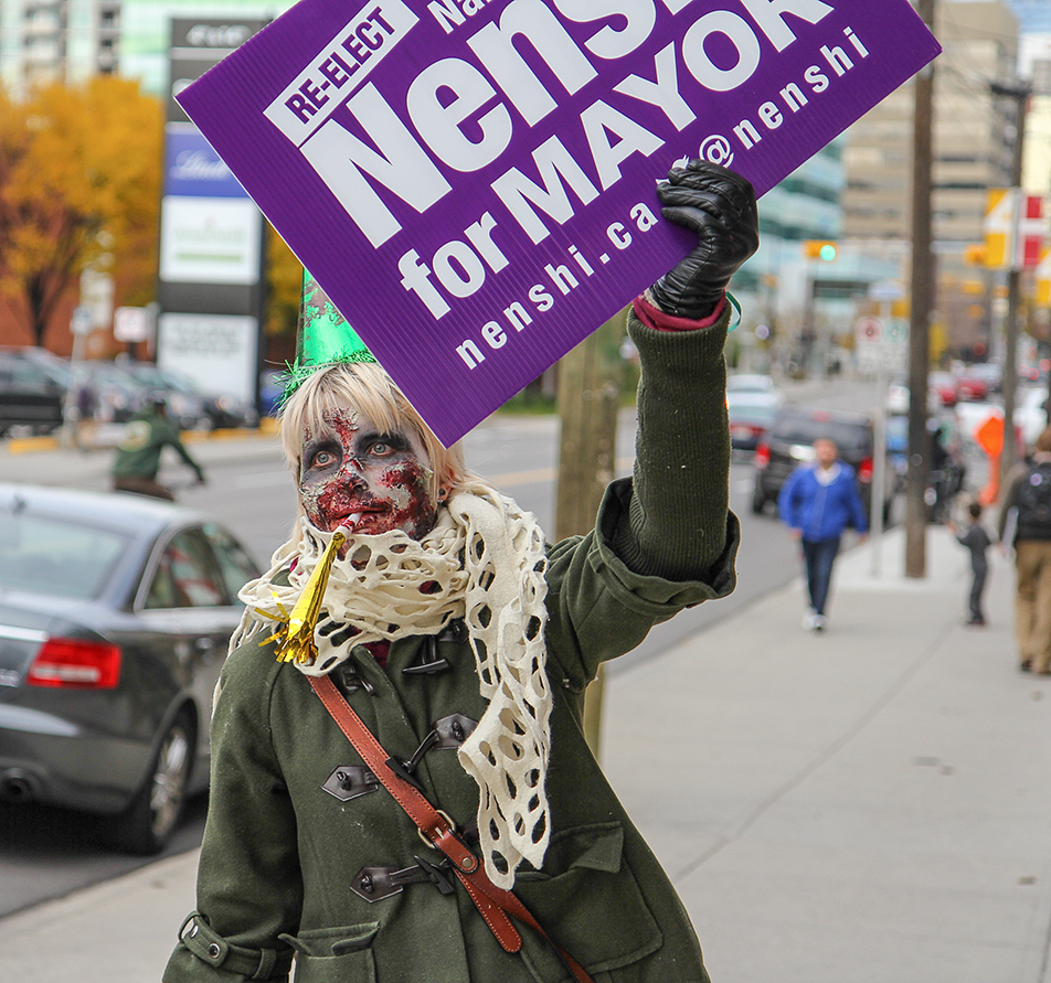 Zombie Apocalypse: Zombie Amanda Froehler shows her support for Naheed Nenshi during the Zombie Walk on Saturday, Oct. 12, 2013. Hundreds gathered for the walk, dressed in their scariest zombie costumes to parade down Stephen Ave. (Photo by Courtney Blatch/SAIT Polytechnic)