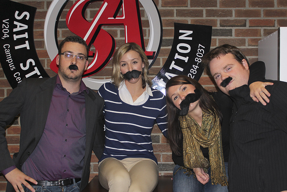 Moustache Mania: SAIT Student Association executive members Thomas Cruickshank, left, Tegan Cochrane, Amanda Hanna and Kenneth Taylor show off their moustaches in support of Movember. (Photo by Stefania Polga/The Press)