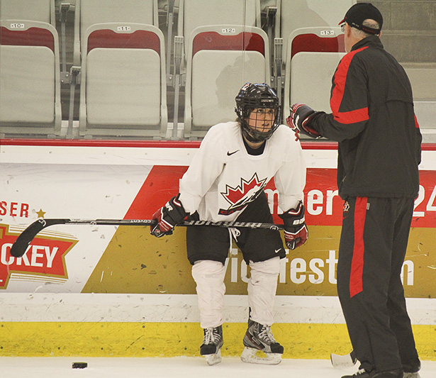 She's All Ears: Vicki Bendus of Team Canada works with skating coach Mark Power in practice at Markin MacPhail arena. (Photo by Sheldon Smith/The Press)