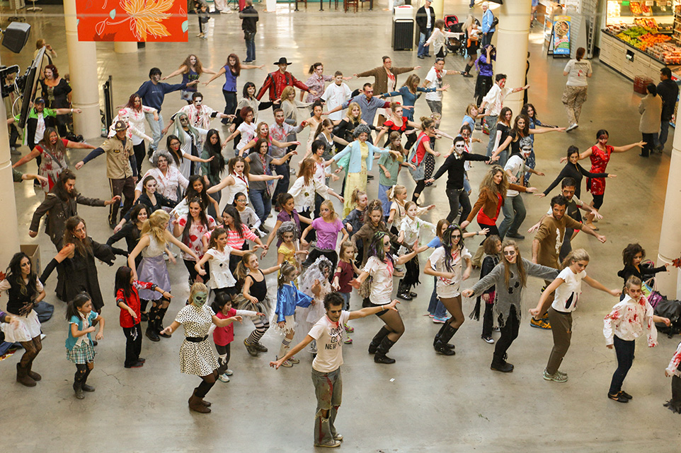 Thrilling: Calgarians dance along to Michael Jackson's 'Thriller' at Eau Claire Market. (Photo by Keith Marinier/The Press)