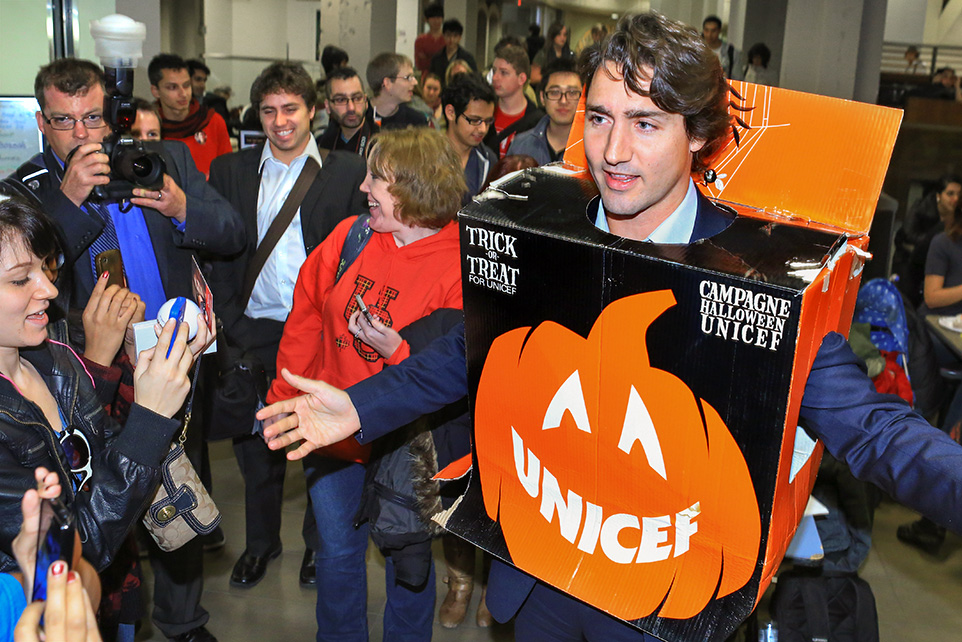 Boxed In: Justin Trudeau, leader of the federal Liberal Party, gets into the Halloween spirit while greeting students at the University of Calgary on Wednesday, Oct. 30, 2013. Trudeau was visiting the city ahead of the rival Conservative Party's national policy convention, which takes place in Calgary from Oct. 31 - Nov. 2. (Photo by Evan Buhler/The Press)