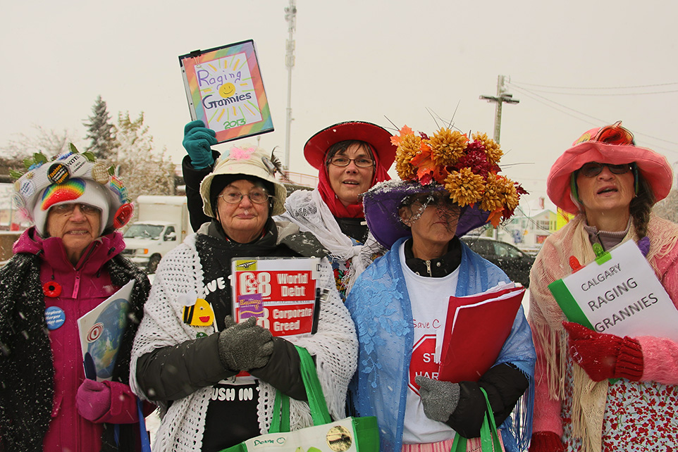 In Protest: Members of a group who call themselves the Raging Grannies attend a protest against FATCA. (Photo by Shealin Boswell/The Press)