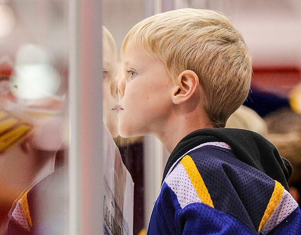 A Nose for Hockey: A young hockey player from the Priddis Panthers gets a closer look as the SAIT Trojans take on the Concordia Thunder on Nov. 8. (Photo by Jenn Pierce/The Press)