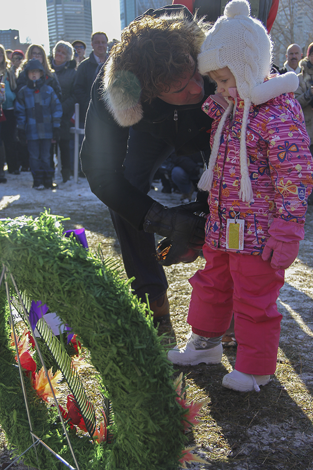 A Generation of Remembrance: Dave Howard (left) and his daughter, 4-year-old Molly Howard, lay a wreath in honour of the Canadian Legacy Project. Howard is the president of the project, which supports disadvantaged youth, seniors and veterans nationwide.