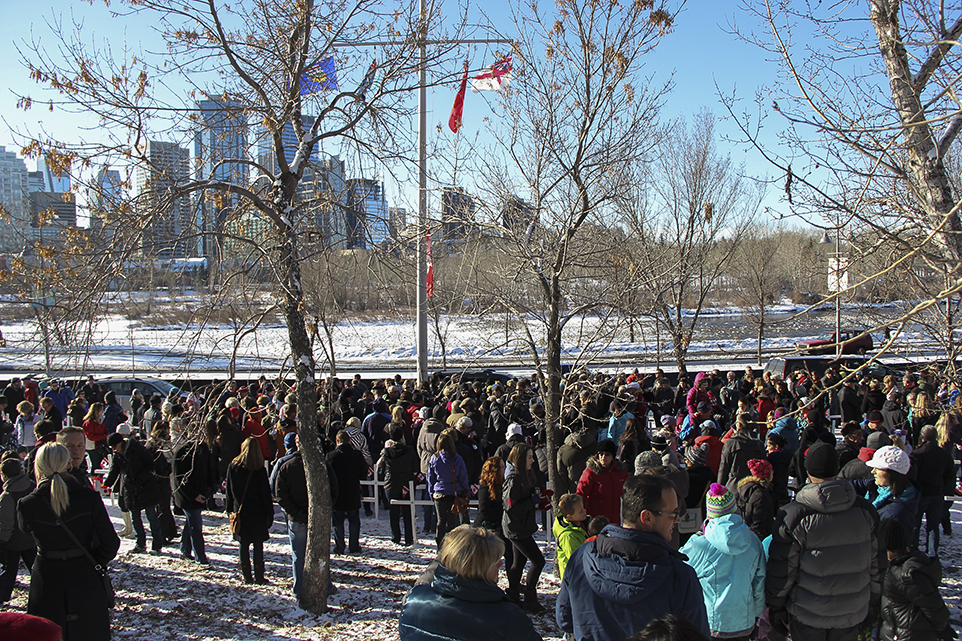 Remembering the Fallen: Hundreds of Calgarians stand within the Field of Crosses Memorial Project on Remembrance Day. (Photo by Monica Henderson/The Press)
