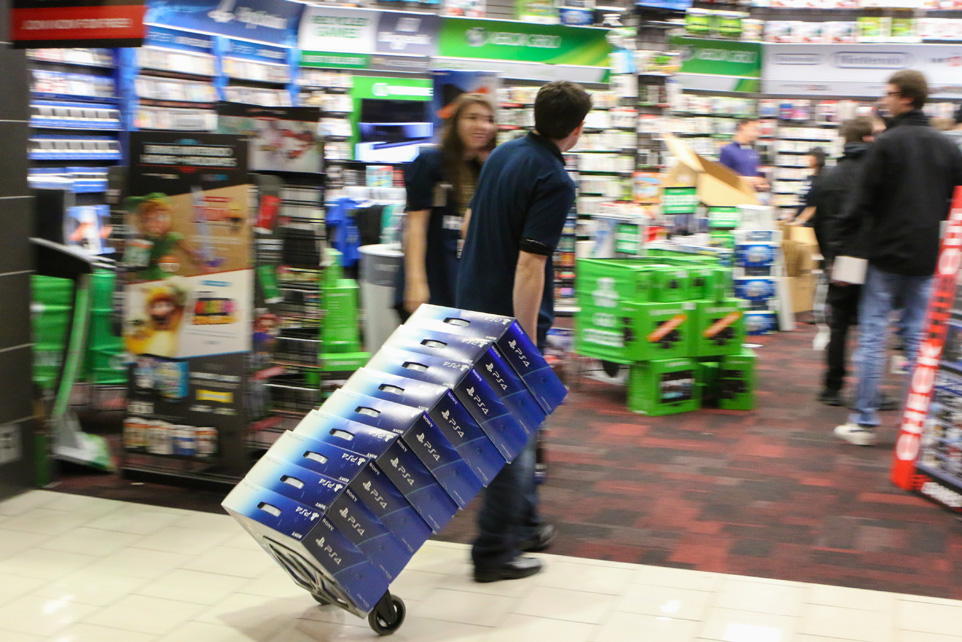 Showtime: EB Games employee Mike Ruddock wheels Sony PlayStation 4 boxes into the store's Southcentre Mall location for the product's midnight release. (Photo by Clayton Seams/The Press)