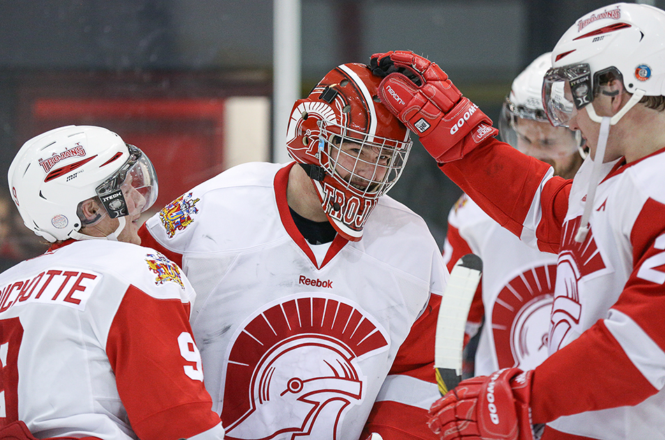 Shutout: Trojan's net minder, Brayden Hopfe, centre, receives congratulations from his team mates as the Trojans shutout the UAA Vikings 3-0 at SAIT arena in Calgary on Saturday, Jan. 18, 2014. (Photo by Jenn Pierce/The Press)