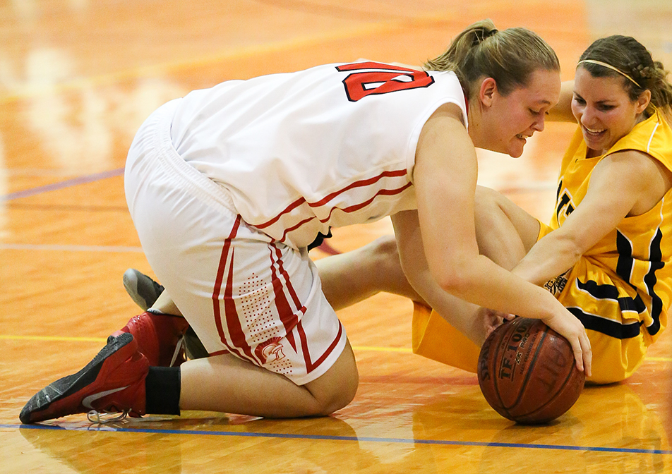 ScrambleSAIT Trojans post Chantel Gaslard takes a spill after colliding with NAIT Ooks forward Robyn Gibson during women's basketball action at the SAIT gymnasium in Calgary on Saturday, Jan. 11, 2014. The Ooks defeated the Trojans by a final score of 54-47. (Photo by Brent Calver/The Press)