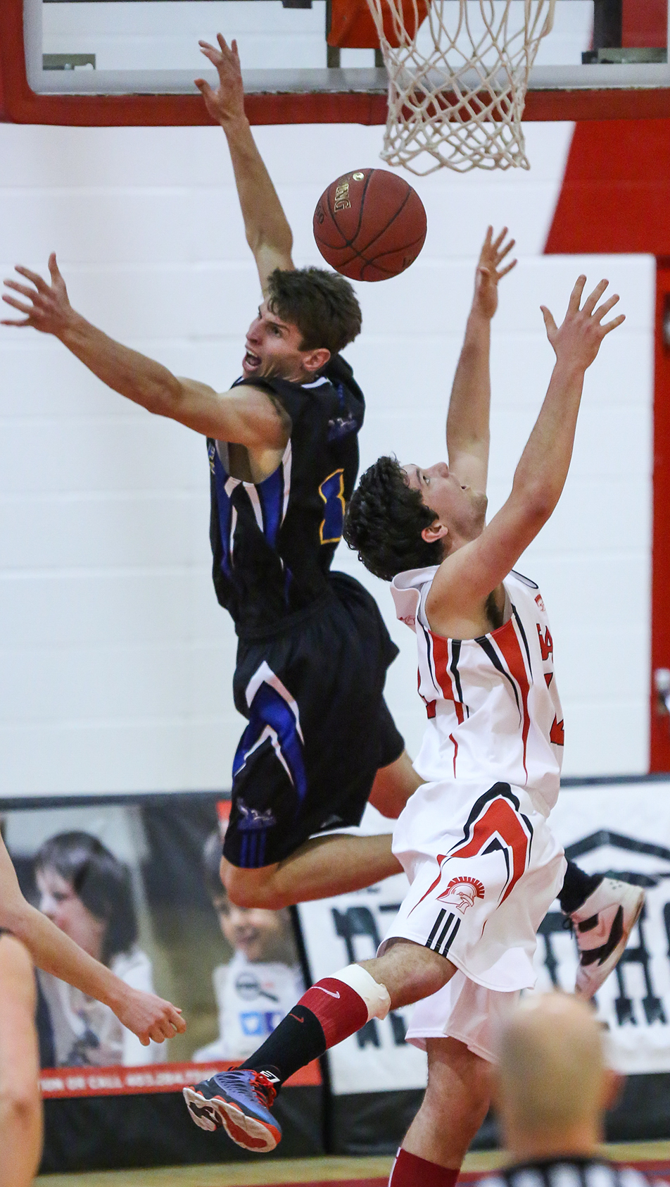 Blocked AgainSAIT Trojans Colten Murray, right, and King's Eagles Ty Gaertner, jump to grab the ball during men's basketball action at the SAIT gymnasium in Calgary on Friday, Jan. 17, 2014. The Trojans defeated the Eagles 83-72. (Photo by Courtney Blatch/The Press)