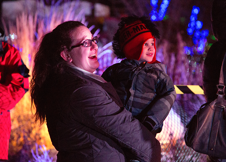 Christmas Lights A mom and her child look can't wait to talk with Santa over a video chat connection at the Zoolights event at the Calgary Zoo Friday, Nov. 29, 2013. The Zoo just reopened after a prolonged partial closure due to the June, 2013 flooding. Over half a million lights are used in the display, which runs from Nov. 29 to Jan. 4. (Photo by Sarah Collins/The Press)