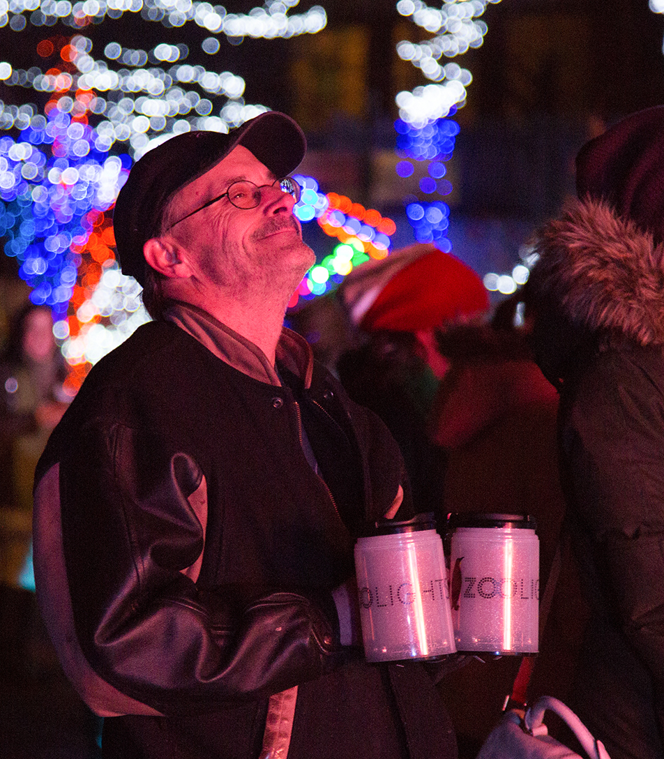 Christmas Lights A man looks at the half-million coloured lights on display at the Zoolights event at the Calgary Zoo Friday, Nov. 29, 2013. The Zoo just reopened after a prolonged partial closure due to the June, 2013 flooding. The display runs from Nov. 29 to Jan. 4. (Photo by Sarah Collins/The Press)