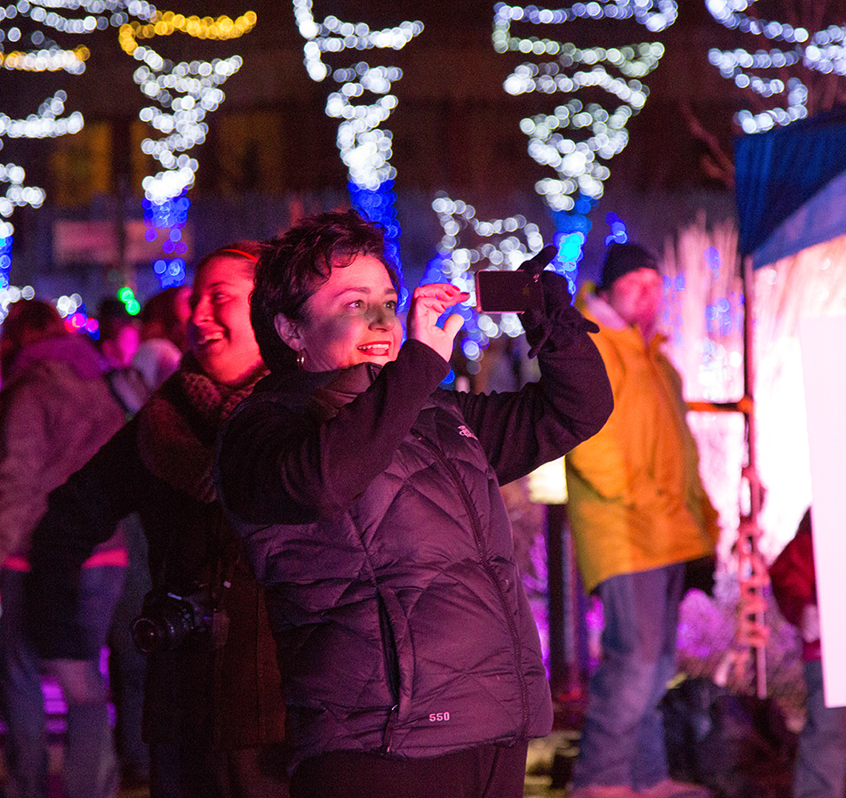 Christmas Lights A mom shoots video of her children as they chat with Santa over video chat connection at the Zoolights event at the Calgary Zoo Friday, Nov. 29, 2013. The Zoo just reopened after a prolonged partial closure due to the June, 2013 flooding. Over half a million lights are used in the display, which runs from Nov. 29 to Jan. 4. (Photo by Sarah Collins/The Press)