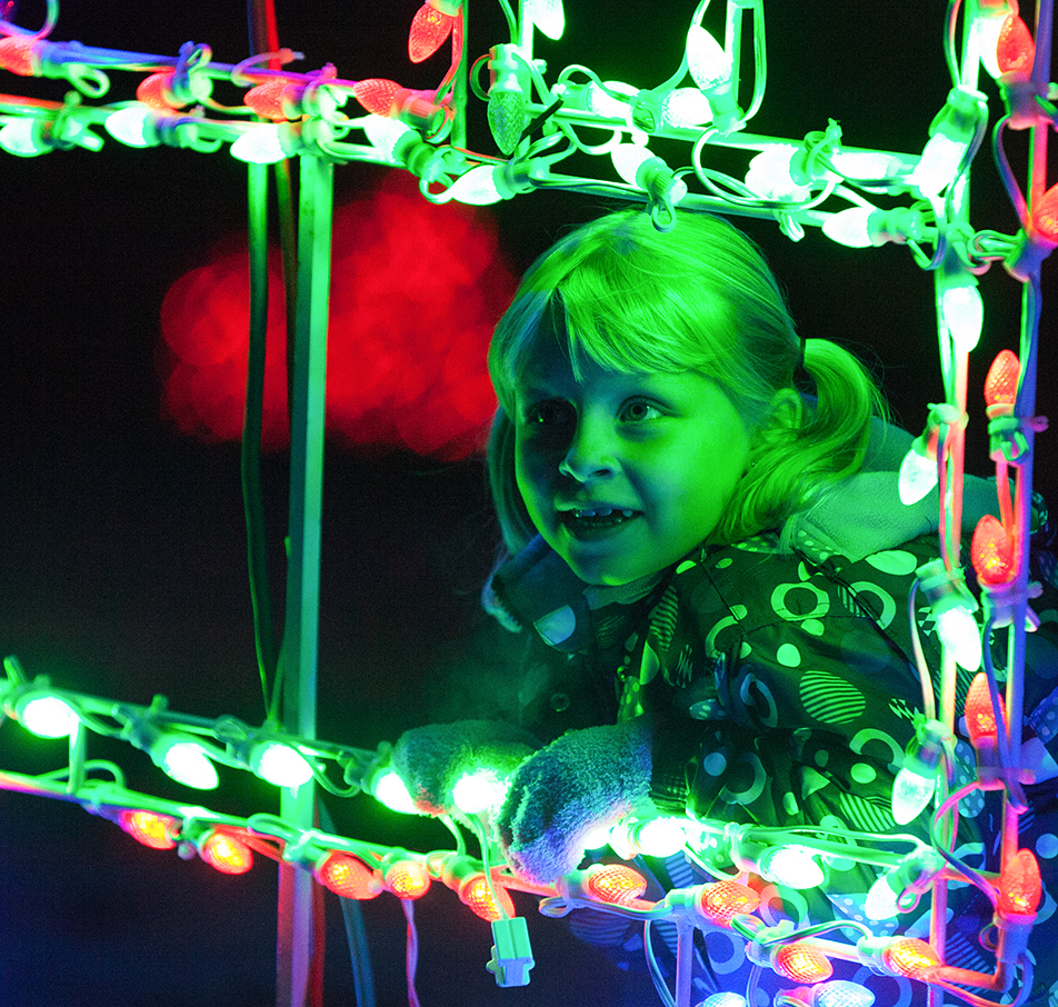 Christmas Lights Kiara Shanks looks at all the Christmas lights on display at the Calgary Lions Club Festival of Lights in Calgary on Saturday, Nov. 30, 2013. The festival has been an annual event for 27 years. (Photo by Brent Calver/The Press)