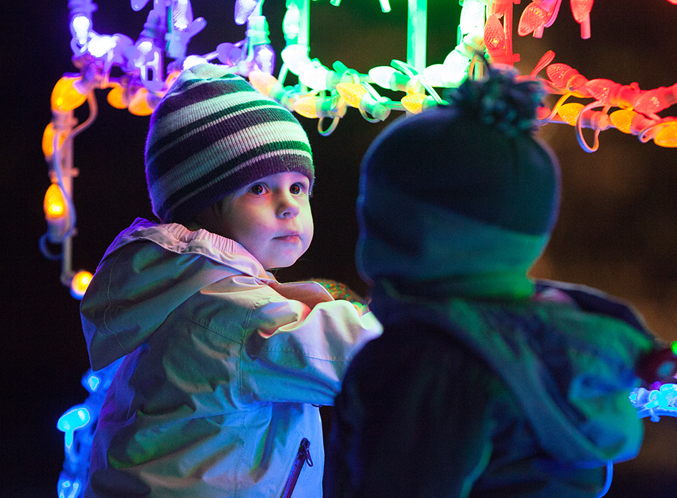 Christmas Dreams Matigan Gardiner looks at all the Christmas lights on display at the Calgary Lions Club Festival of Lights in Calgary on Saturday, Nov. 30, 2013. The festival has been an annual event for 27 years. (Photo by Brent Calver/The Press)