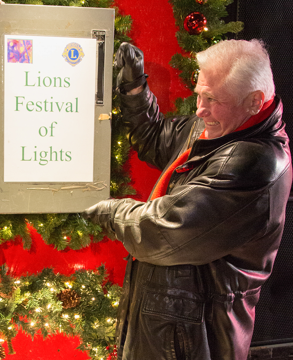 Flip the Switch Ward one Alderman Ward Sutherland flips the switch, activating the lights and setting off fireworks at the Calgary Lions Club Festival of Lights in Calgary on Saturday, Nov. 30, 2013. The festival has been an annual event for 27 years. (Photo by Brent Calver/The Press)