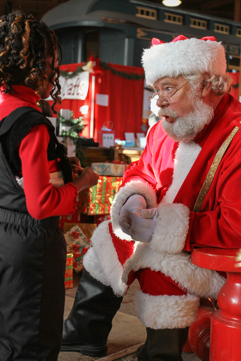 "Christmas Dreams Santa greeted a long line of kids in his ""Workshop"", set up in the Railway Roundhouse at Heritage Park in Calgary on Saturday, Nov. 23, 2013. Heritage Park's Once Upon a Christmas event runs weekends from Nov. 23 to Dec. 22. (Photo by Keith Marinier/SAIT Polytechnic)"
