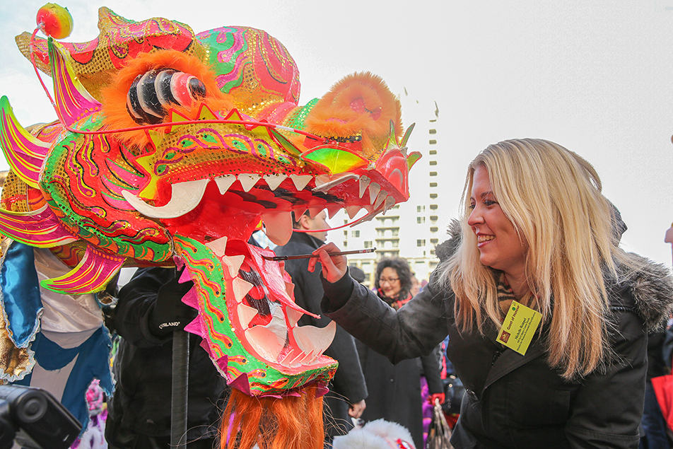 Ferocious Lion: Calgary City Centre-North MP Michelle Rempel, paints a dragon head for the 2014 Chinese New Year celebration. (Photo by Brent Calver/The Press)