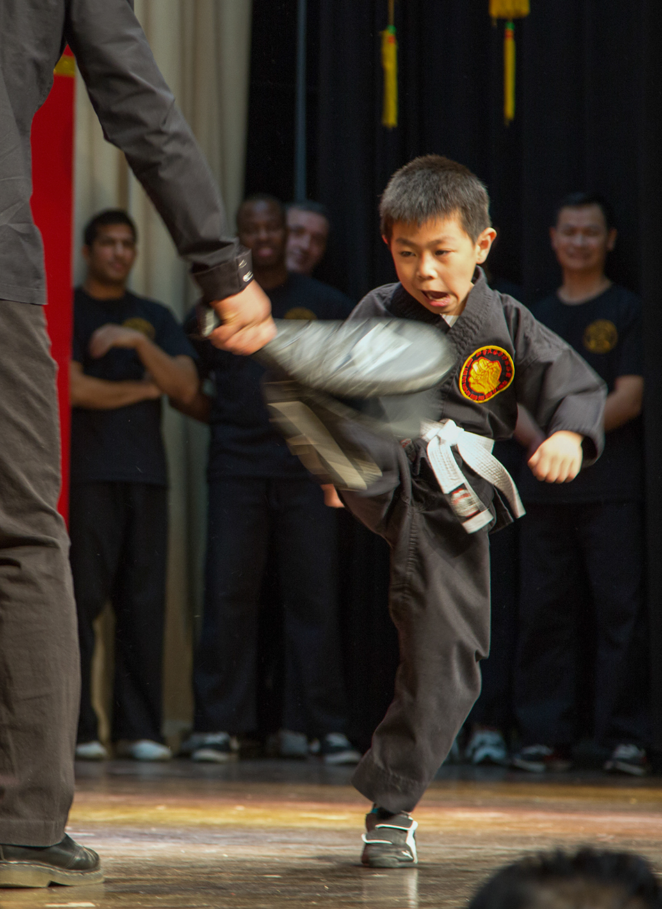 Karate Master: The youngest martial artist of the crew shows off his skills during the Chinese New Year celebrations. (Photo by Sarah Collins/The Press)