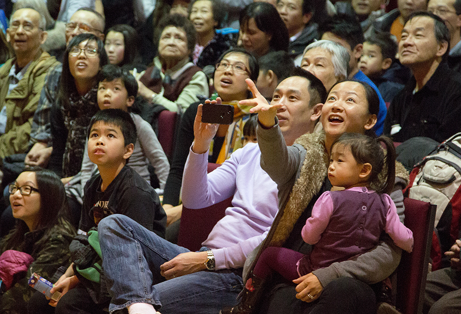 Proud Parents: The crowd reacts to the Kugekai Lion Dance Team during Chinese New Year celebrations. (Photo by Sarah Collins/The Press)