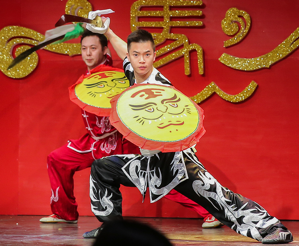 Traditional Dance: Members of the Chinese Cultural Society perform a Chinese sword dance during Chinese New Year celebrations. (Photo by Courtney Blatch/The Press)