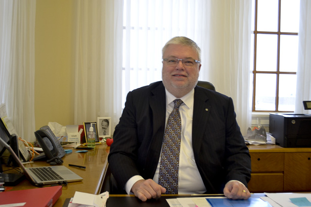 David Ross: SAIT President and CEO, David Ross, poses for The Press in his office on the third floor of Heritage Hall on March 6. (Photo by Yashica Anandani /The Press)
