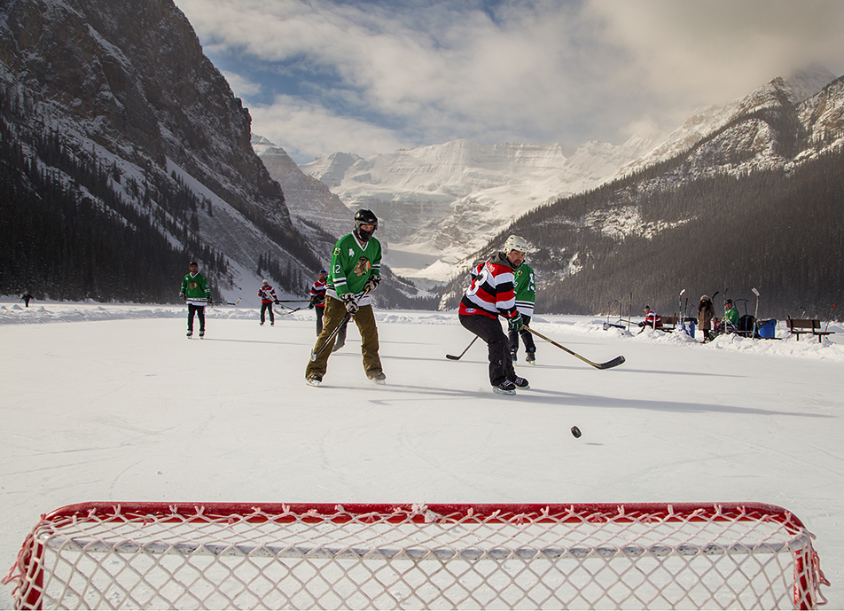 Picturesque: Teams compete 4 on 4 in the 5th annual Lake Louise Pond Hockey tournament at Chateau Lake Louise on Sunday, Feb. 23, 2014. Temperatures during the tournament felt like -29C. (Photo by Jenn Pierce/The Press)