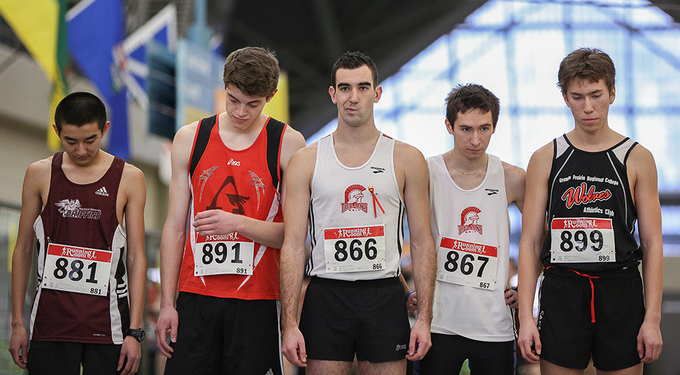 Pre-Race Nerves: Competitors wait nervously at the starting line for the 1500m race to begin at the Trojan invitational indoor track meet at the Talisman Centre in Calgary on Saturday, Feb. 1, 2014. This is the first year that indoor track has been part of the ACAC athletic circuit.  (Photo by Jenn Pierce/The Press)