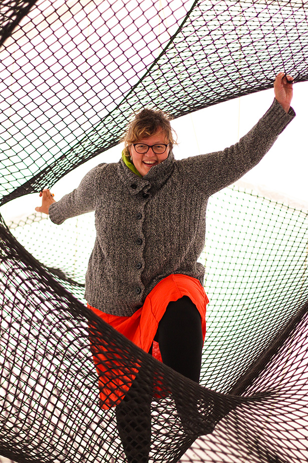 Nothing But Net: Agnieszka Wolska-Chaney tries to keep her balance as she climbs and explores the three levels of Net Blow-Up. (Photo by Nancy Juarez/The Press)