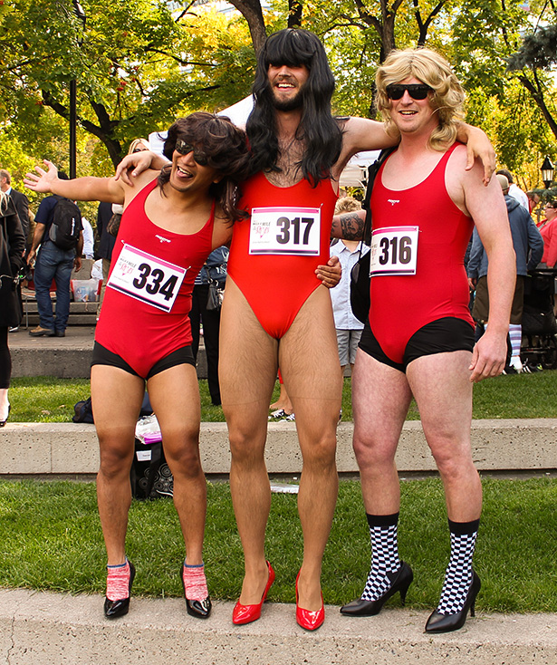 Baring Everything: Andrew Julio, right, Joey Post, centre, and Nick Kuhn sport some revealing apparel as they prepare to walk two laps around Olympic Plaza for the YWCA's ninth annual Walk a Mile in Her Shoes event. (Photo by Nancy Juarez/The Press)