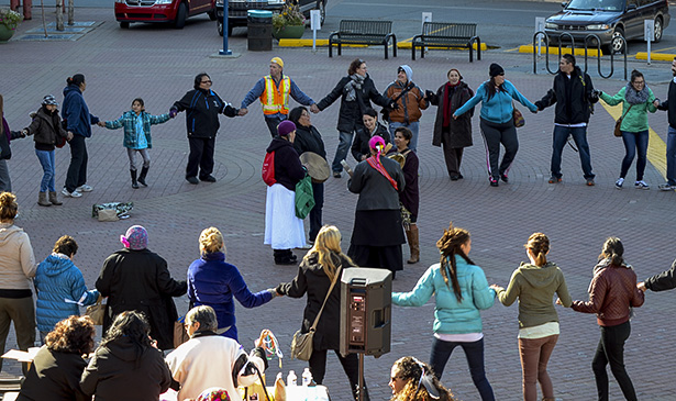 Coming Together: The tenth annual Sisters in Spirit Walk ended in a round circle dance to drum at Eau Claire Market. (Photo by Jenna Dulewich/The Press)