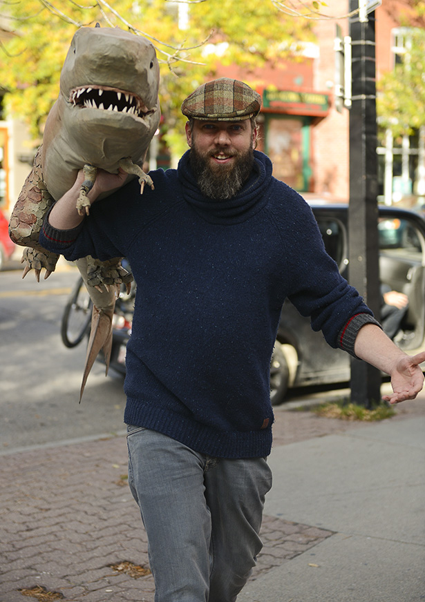 Spencer Estabrooks showing off the Sharkasaurus from his latest film, Sharkasaurus, in front of Plaza Theater in Kensington in Calgary.(Photo by Kelsey Oster/The Press)