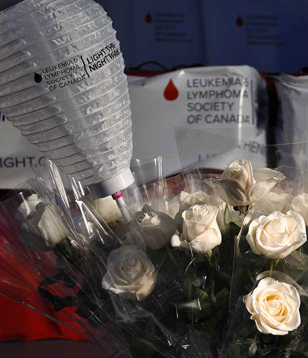 A bouquet of white roses decorate the mainstage at LLSC's Light the Night Walk Saturday, Oct. 4, 2014. Several speakers, including cancer survivor Matthew Saville, had the opportunity to speak of their own experiences with blood cancer before the walk began,