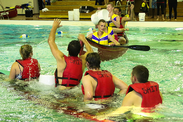 Intramural teams fight and splash  in Battleship H2O in Calgary on Tuesday, Oct. 7, 2014. 'Titanic' sinks into the water like it's predecessor before as 'Dripping Wet' cheers. (Photo by Jenn Gardiner /The Press)