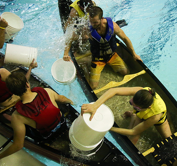 Intramural teams fight and splash in Battleship H2O in Calgary on Tuesday, Oct. 7, 2014. Teams were crafty and pulled in close to dump full buckets in. (Photo by Jenn Gardiner /The Press)