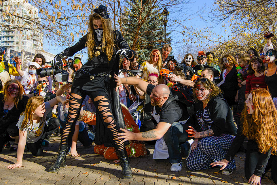 Lunch Time: Zombie-costumed Calgarians gather during Zombie Walk in Calgary on Saturday, Oct. 18, 2014. (Photo by Yasmin Mayne/The Press)