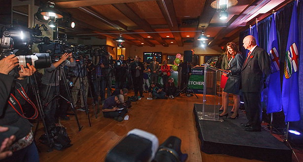 Facing Reality: Wildrose party leader Danielle Smith, at the mic, addresses supporters in Calgary on Monday, Oct. 27, 2014. She was joined at the podium by Calgary-Elbow candidate John Fletcher. All four Wildrose candidates lost. (Photo by Mikaela MacKenzie/The Press)