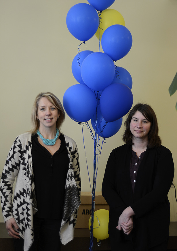 The masterminds: Shelann McQuay, left, and Julie Egers, stand by Happy Monday event balloons in the Student Development & Counselling waiting room in Calgary on Tuesday, Jan. 20. McQuay and Egers helped start the 28 Days of Happiness initiative. (Photo by Angela Brown/The Press)
