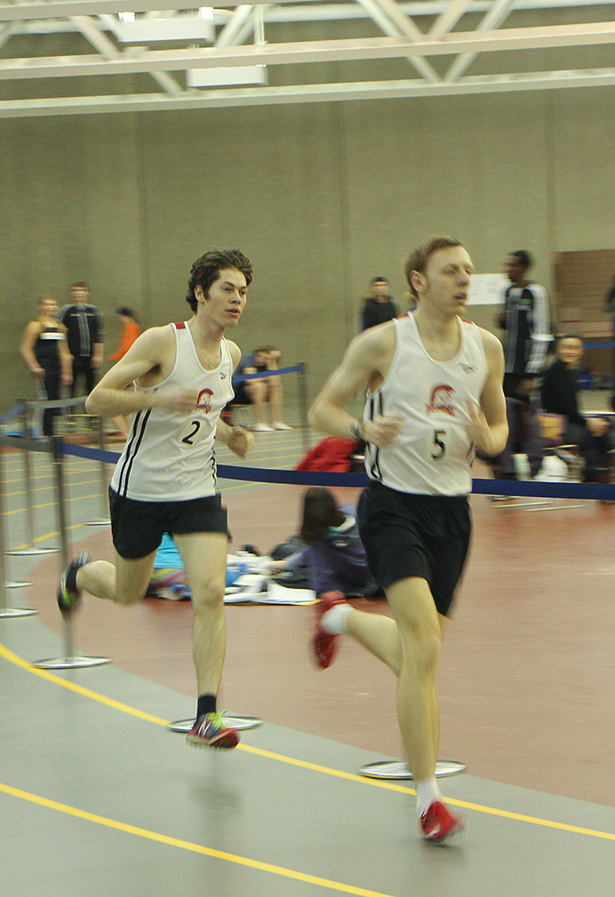 On Track: Sean Hickey, right, and Timothy Huynh run the 3000m race at the Jack Simpson Gymnasium on Sunday, Feb. 1, 2015. (Photo by Enrique Palacios/The Press)