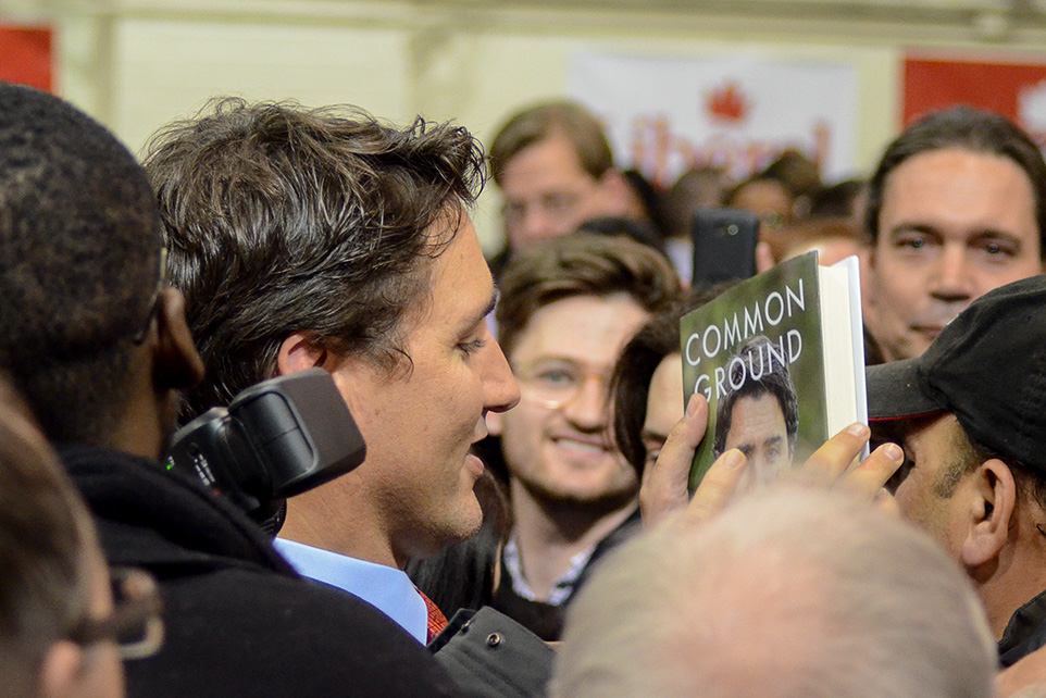 Shaking hands: Trudeau stayed after his speech to mingle with crowd, signing books, taking selfies for half an hour before leaving the Kerby Centre. (Photo by Jenna Dulewich/The Press)