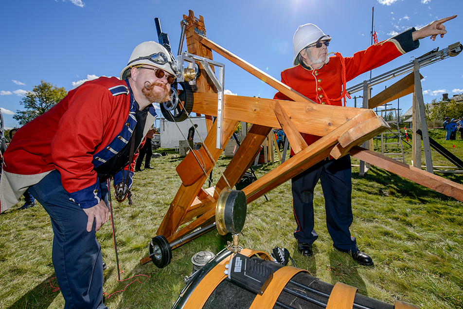 Catharsis Catapult: Mike Johnson, left and Andy Anderson reveal their steam powered catapult at Beakerheads's Catharsis Catapult Competition at Fort Calgary on Sunday, Sept. 20, 2015. Both are members of the Steam Punk Assemblage of Calgary. (Photo by Andy Maxwell Mawji /The Press)