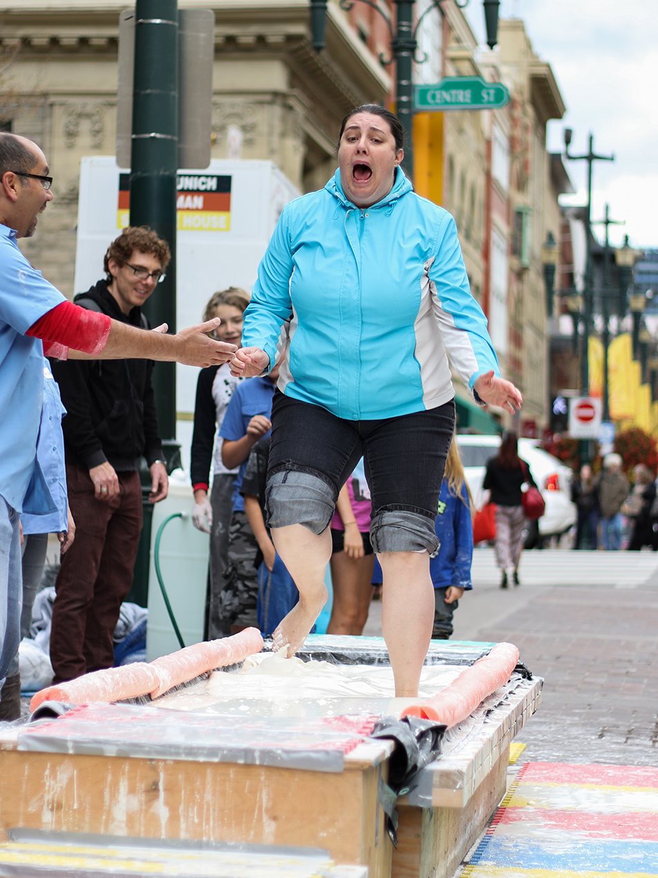 Beakerhead Fun: A woman reacts to the artificial quicksand she's running through during a Beakerhead exhibition event on Stephen's Avenue mall in downtown Calgary. (Photo by Joshua Neumann/SAIT Polytechnic)