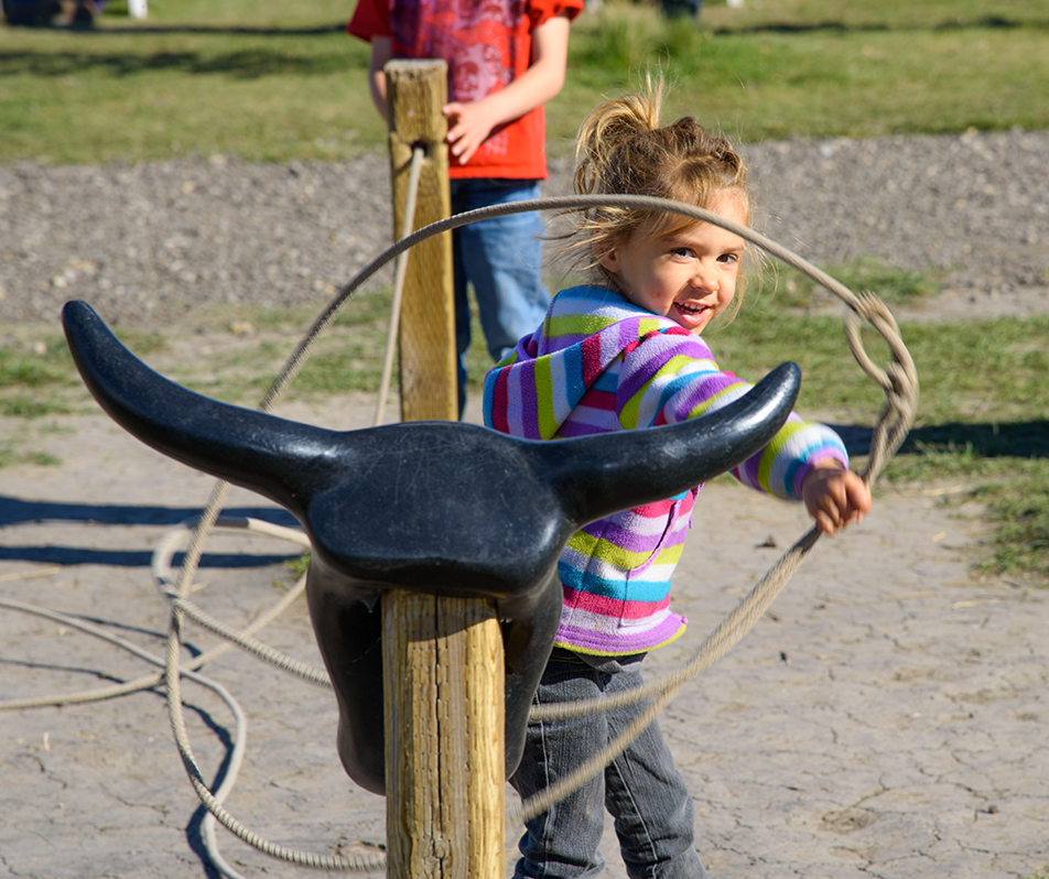 Little Roper: Sarah learns to lasso at the calf roping attraction at Calgary's Corn Maze and Fun Farm on Sunday, Sept. 27, 2015. Sarah's father taught her to lasso earlier that day. (Photo by Brooke Hovey/The Press)