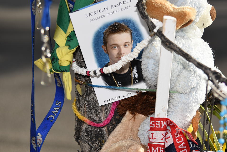 Heartfelt Scene: A heart necklace, among many other mementos, is placed near a photo of 16-year-old Nickolas Paswisty at a memorial set up near the site of a fatal accident which killed the Calgary teen in the community of Erin Woods. (Photo by Victoria Vadeboncoeur/The Press)
