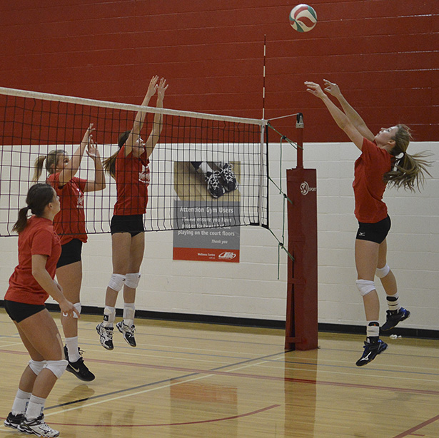 Strong Start!: The Trojans women's volleyball team during practice at SAIT's Campus Centre gym. The team is coming off a strong 2014-15 season. (Photo by Jessica Phillips/The Press)